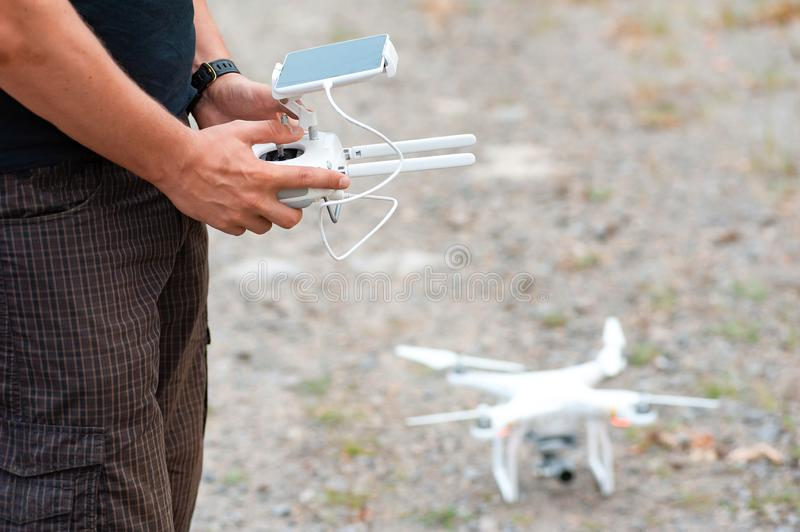 Man holding remote control panel from drone stock photos