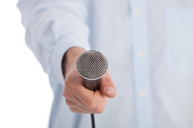 Download Man Holding A Retro Microphone Towards The Camera Stock Photo - Image: 35915690