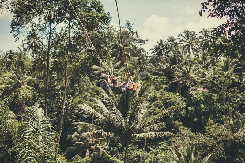 Man Holding on Rope in Forest royalty free stock photography