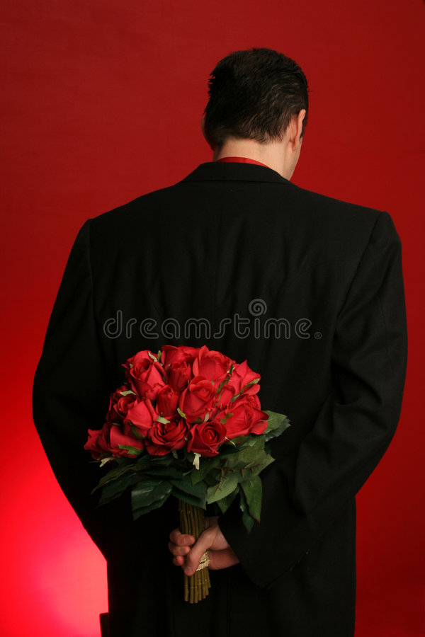 Download Man Holding Roses Behind His Back Stock Photo - Image of dozen, hiding: 423354