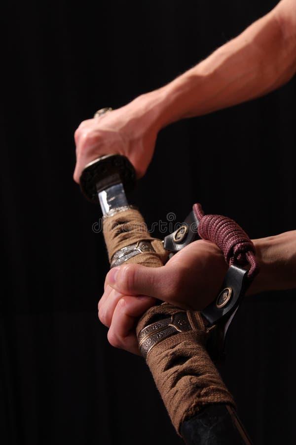 Man holding samurai sword stock photography