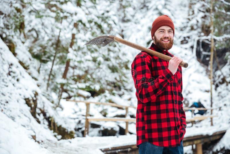 Man holding shovel outdoors stock images