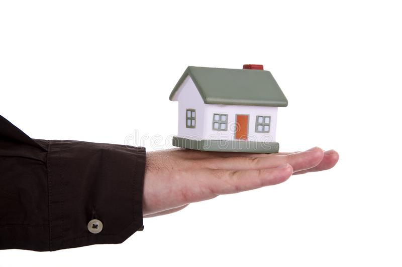 Man holding a small house royalty free stock image