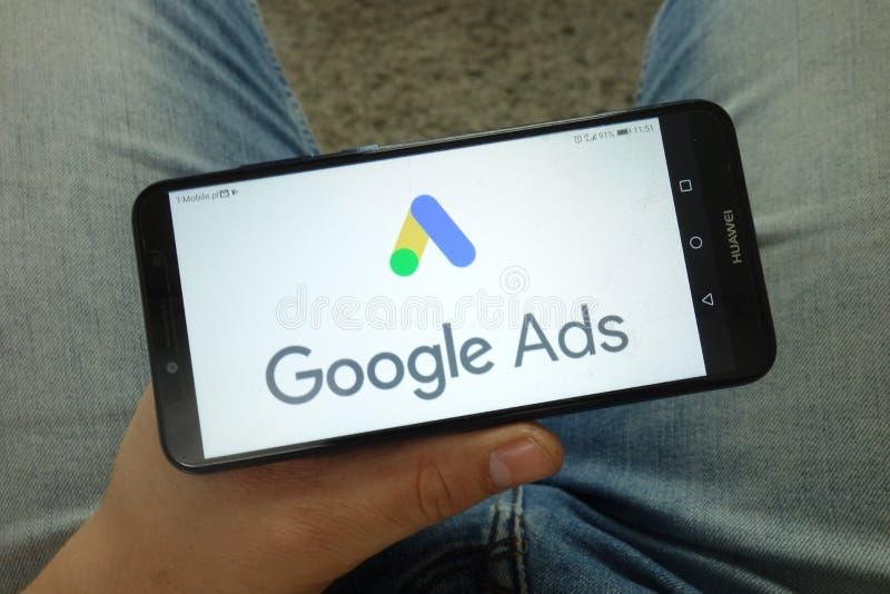 Man holding smartphone with Google Ads online advertising platform logo. KONSKIE, POLAND - April 13, 2019: Man holding smartphone with Google Ads online royalty free stock image