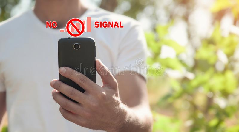 Man holding smartphone. No signal royalty free stock images