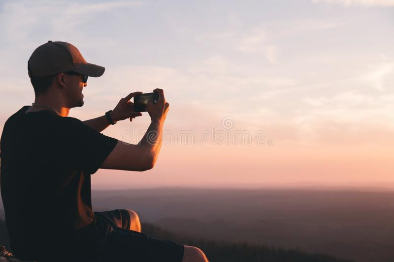 Man Holding A Smartphone And Taking A Photo Of A View Free Public Domain Cc0 Image
