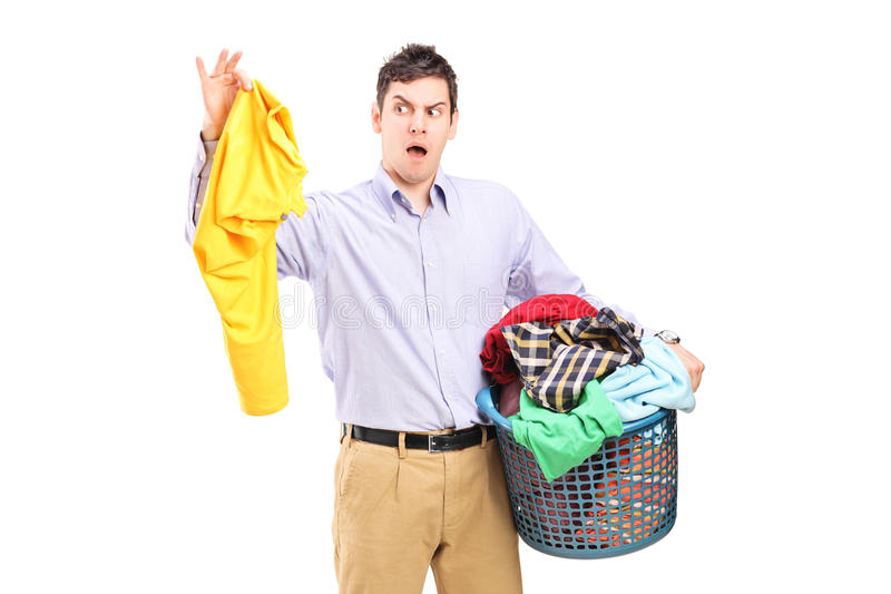Download Man Holding A Smelly Blouse And A Laundry Basket Stock Photo - Image: 28994170