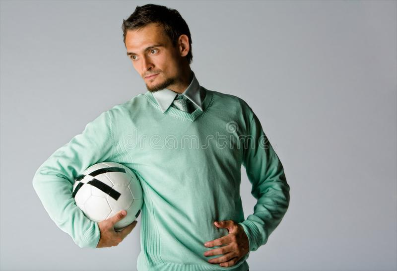 Man Holding Soccer Ball Free Stock Photography