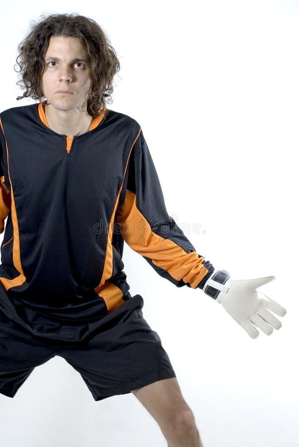 Man Holding Soccer Ball - Vertical stock photography