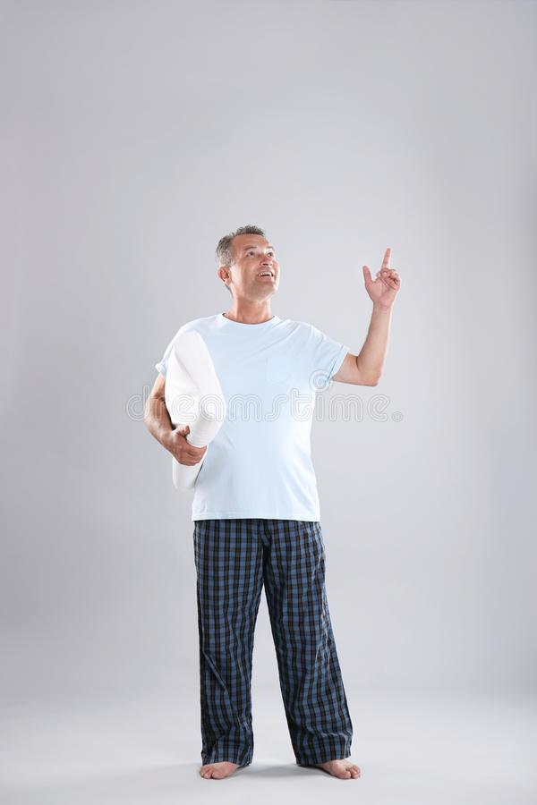 Man holding soft pillow. On light background stock image