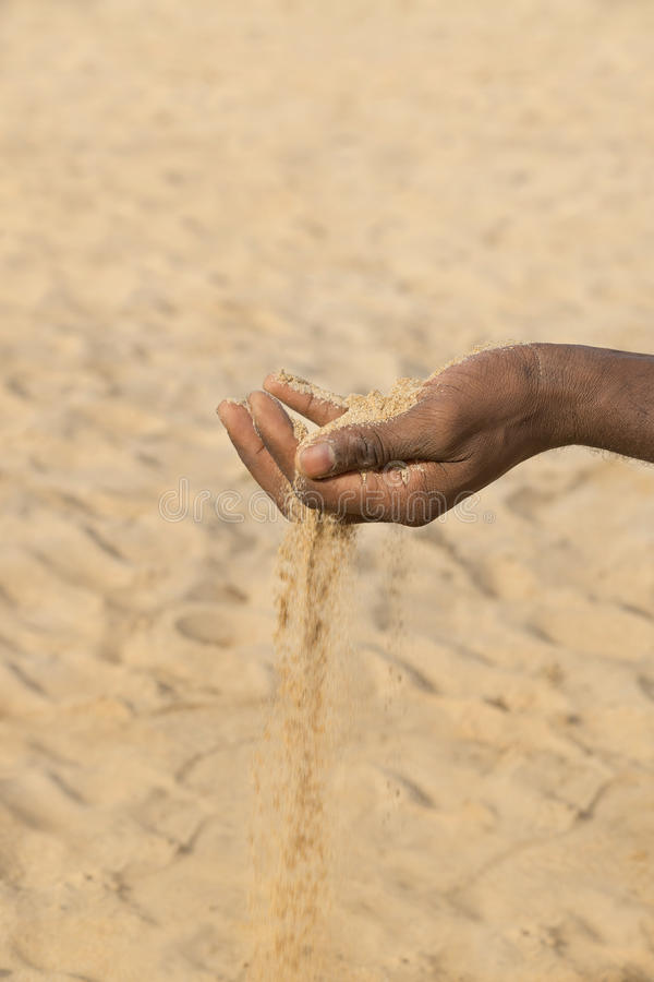 Man holding some sand in the hand: drought and desertification. Man holding some sand in the hand : drought and desertification royalty free stock photography