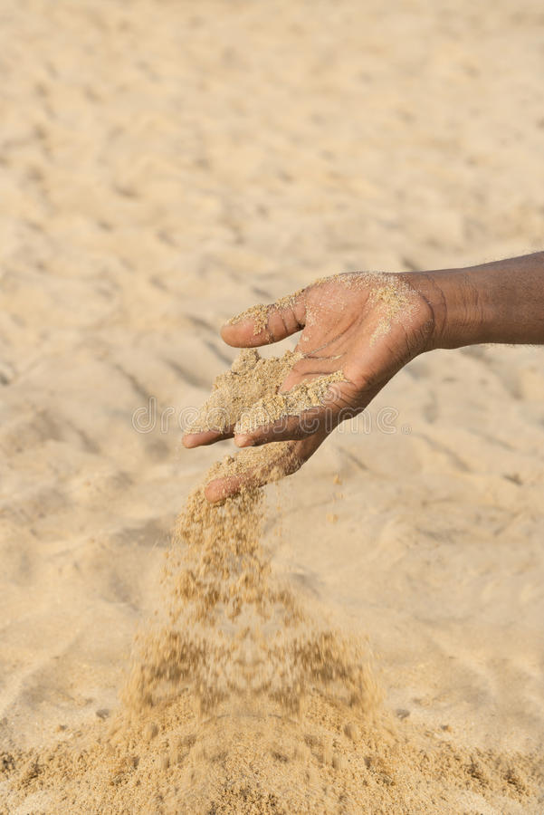 Man holding some sand in the hand: drought and desertification. Man holding some sand in the hand : drought and desertification stock photos