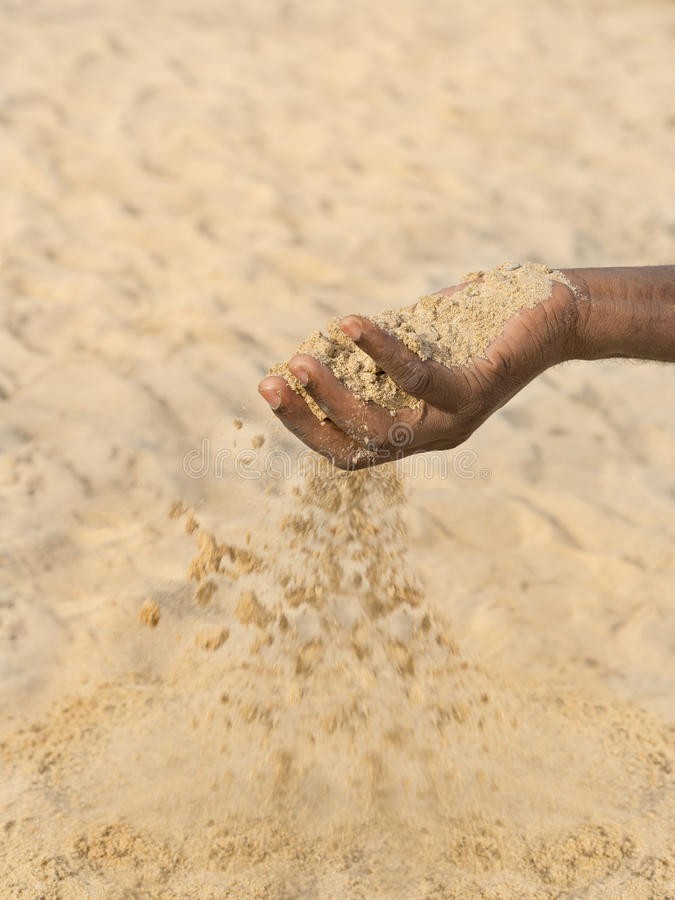 Man holding some sand in the hand: drought and desertification. Man holding some sand in the hand : drought and desertification royalty free stock image