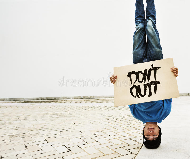 Man Holding Speech Sign Do not Quit Concept royalty free stock photography