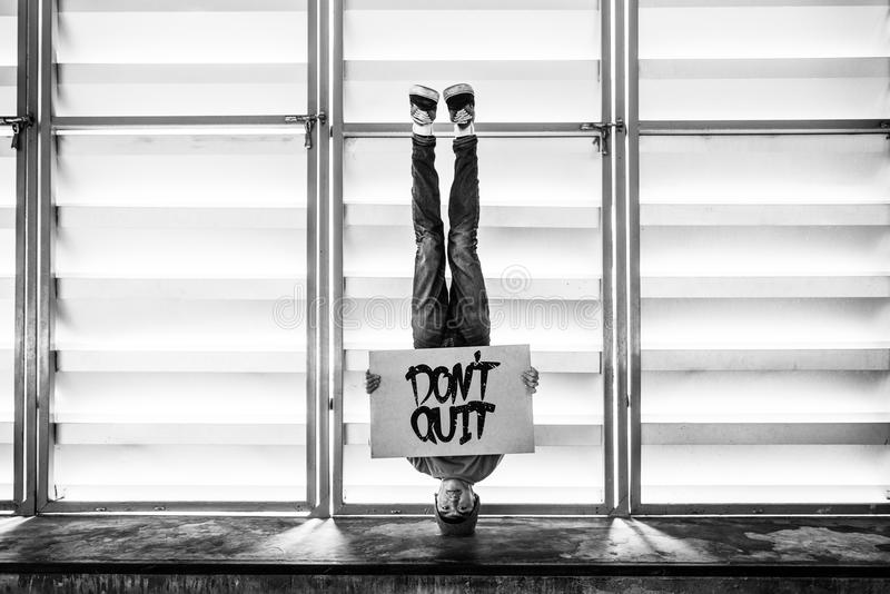 Man Holding Speech Sign Don`t Quit Cocncept. Man Holding Speech Sign Don`t Quit royalty free stock photography