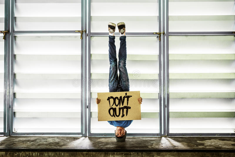 Man Holding Speech Sign Don`t Quit Concept. Man Holding Speech Sign Don`t Quit royalty free stock photography