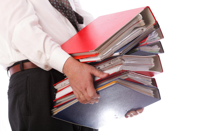 Man holding stack of folders - Isolated. Man holding stack of folders Pile with old documents and bills. Isolated on white background royalty free stock image