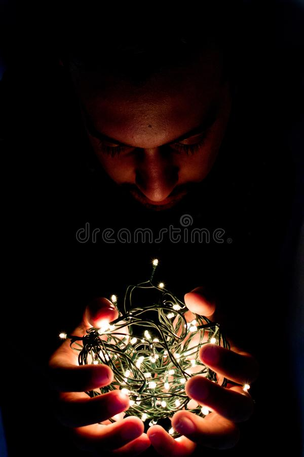 Man Holding String Light royalty free stock photos