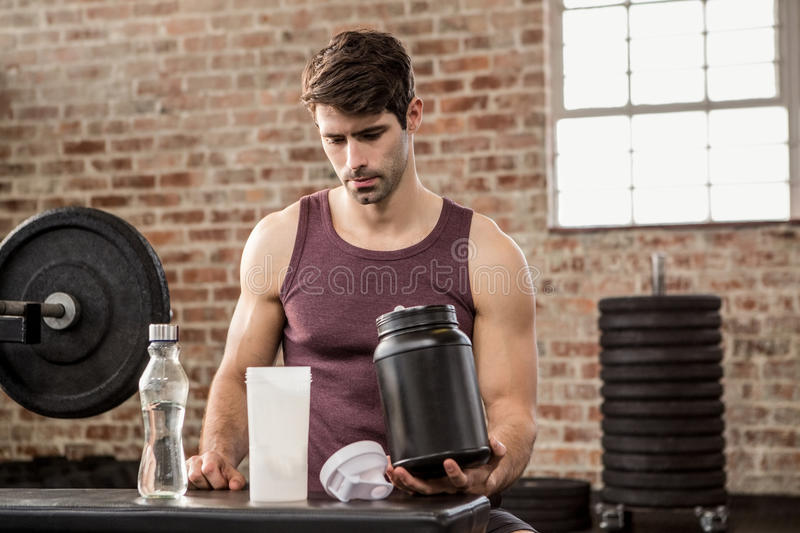 Man holding supplement tin stock photography