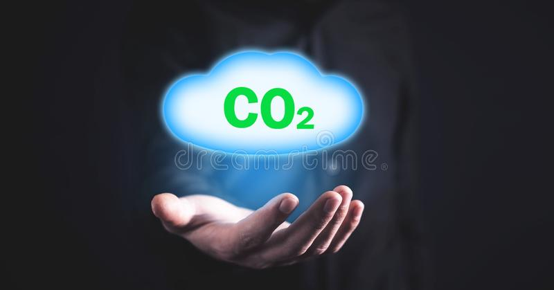 Man holding symbol CO2 with cloud royalty free stock photos
