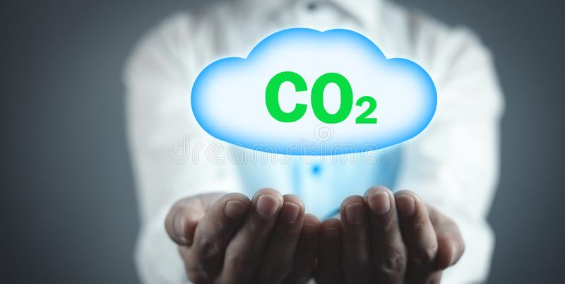 Man holding symbol CO2 with cloud stock images