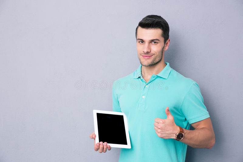 Man holding tablet computer and showing thumb up royalty free stock photos