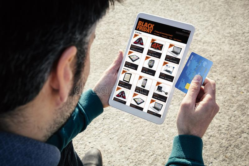 online shopping black friday tablet credit card royalty free stock image