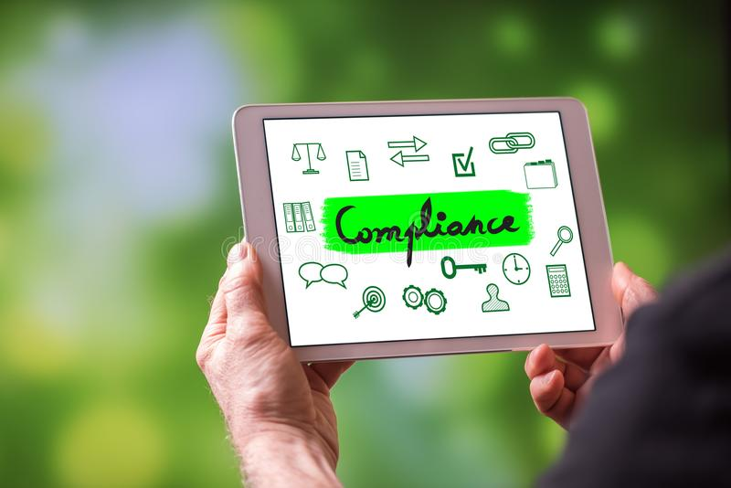 Compliance concept on a tablet stock image