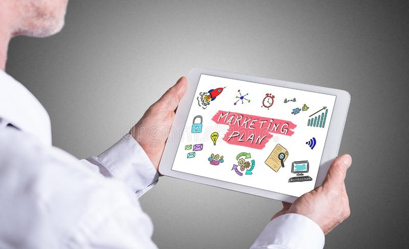 Marketing plan concept on a tablet royalty free stock photo