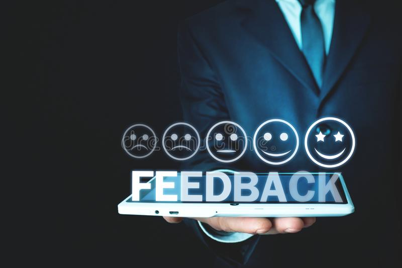 Man holding tablet with word Feedback. Business concept royalty free stock photos
