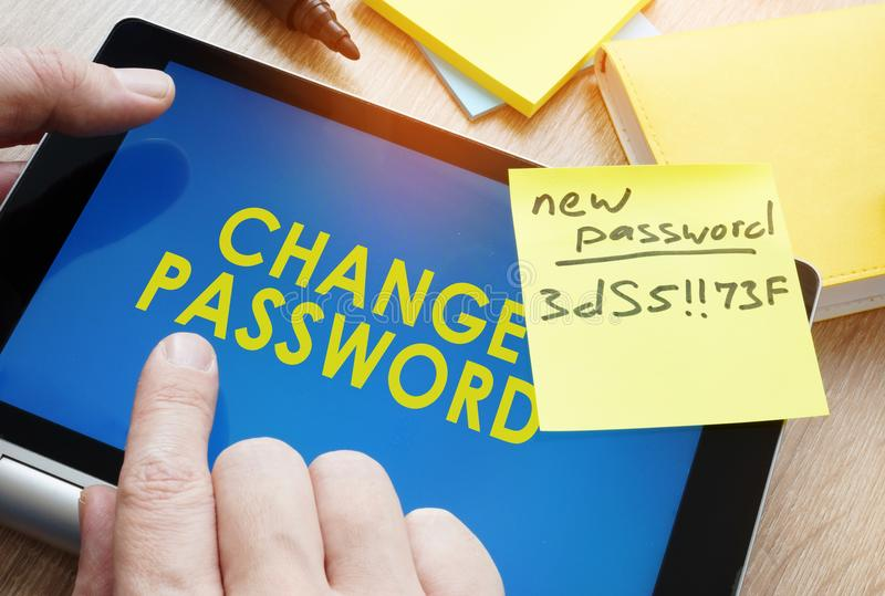 Man holding tablet with words change password from weak to strong. stock photo