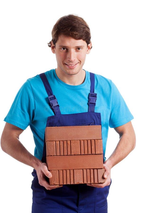 Free Man Holding The Bricks Stock Photos - 38149313