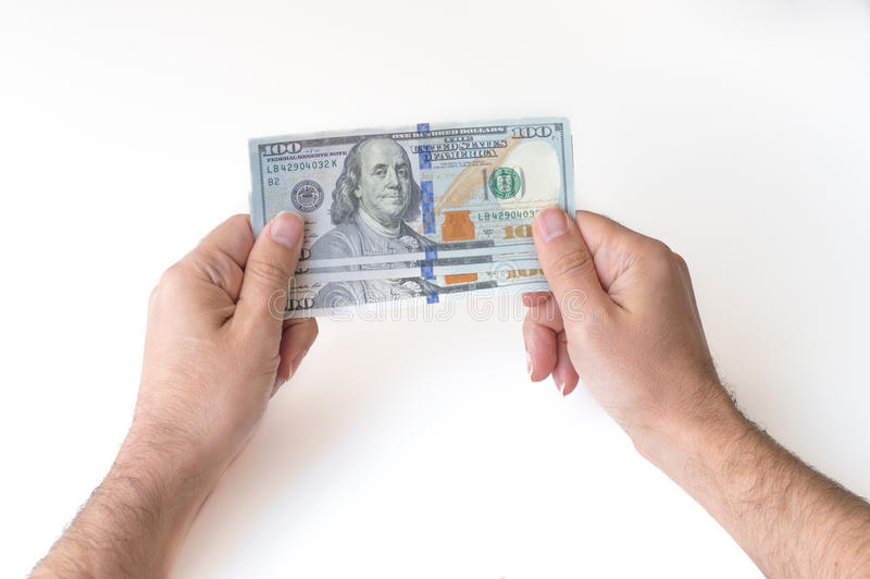 Man holding three hundred US Dollars. In his hands royalty free stock photography