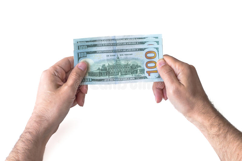 Man holding three hundred US Dollars. In his hands stock images
