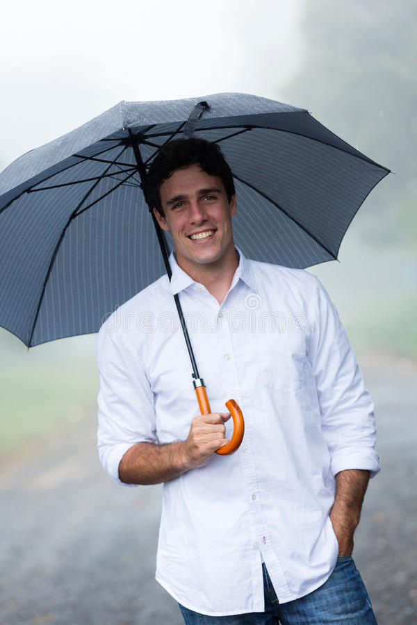 Man holding umbrella royalty free stock images