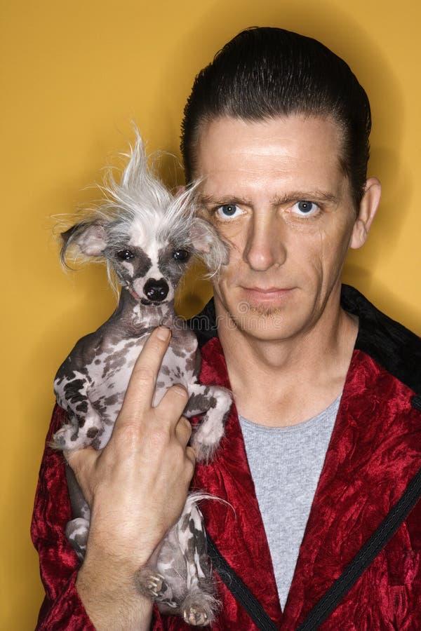 Man holding unique dog. royalty free stock photo