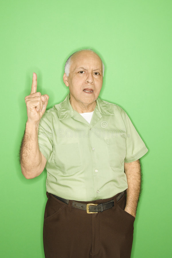 Man holding up one finger. Caucasian mature adult male holding up one finger royalty free stock image