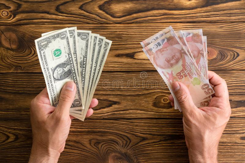 Man holding USD and Turkish lira in his hands royalty free stock images