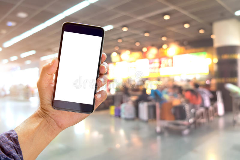 Man holding and using smartphone at check in terminal airport background. stock photography