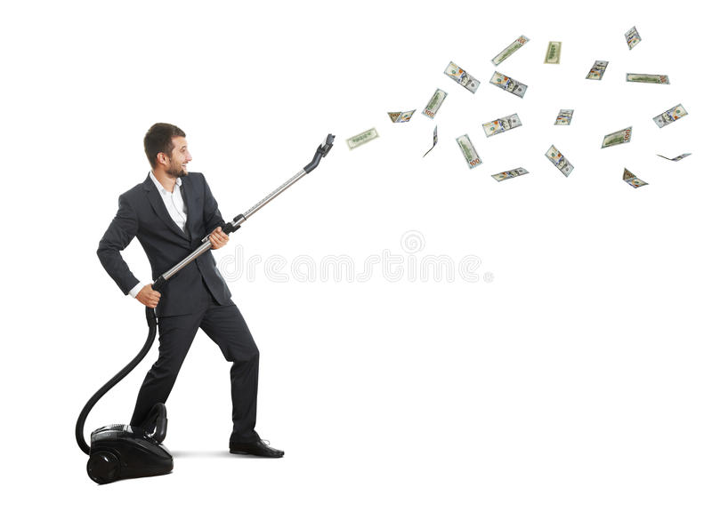Man holding vacuum and catching money royalty free stock photos