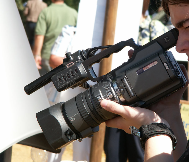 Download Man Holding Video Camera Stock Photo - Image: 1713340