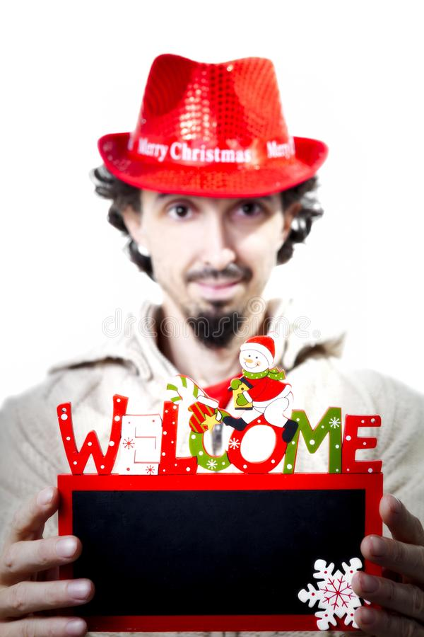 Man is holding a welcome blackboard stock images