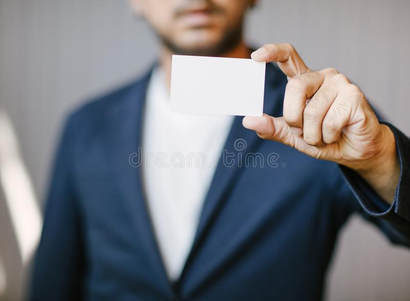 Man holding white business card royalty free stock image