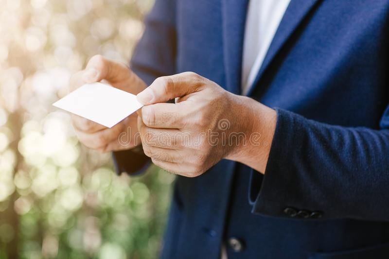 Man holding white business card royalty free stock photography