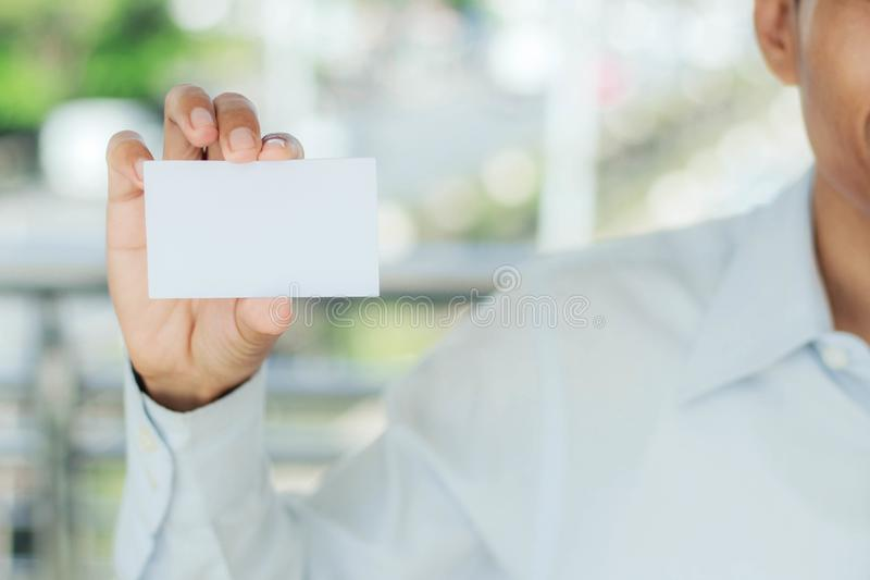 Man holding white card. stock images