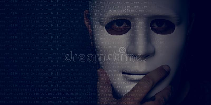 Man holding a white mask in the shadows royalty free stock photo