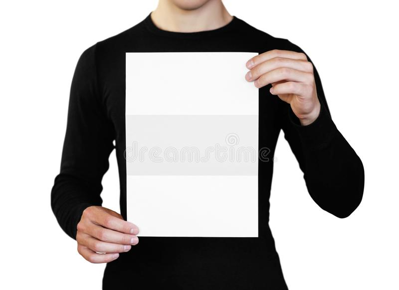 A man holding a white sheet of paper. Holding a booklet. Close up. Isolated on white background stock image