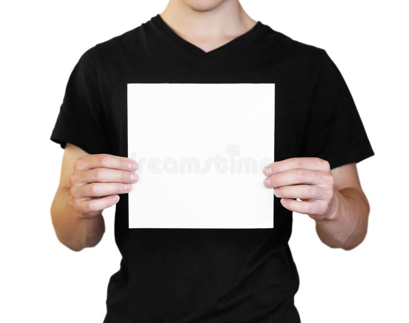 A man holding a white sheet of paper. Holding a booklet. Close up. Isolated on white background royalty free stock image
