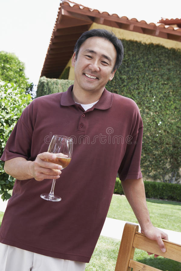 Man Holding Wineglass In Garden stock image