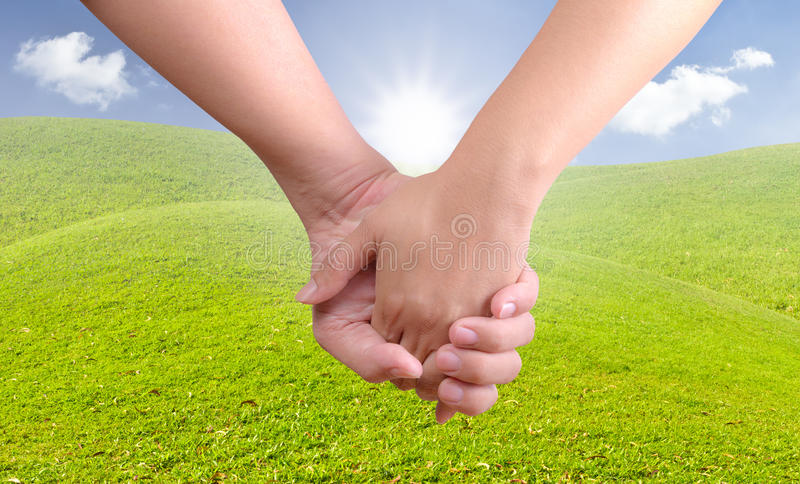 Man holding woman hand. On new day stock image
